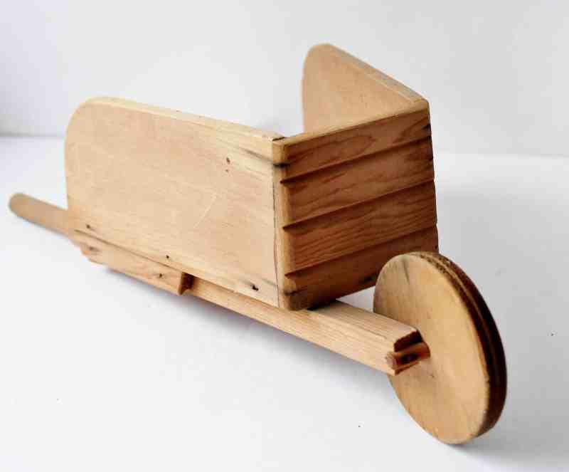 Small vintage wooden wheel barrow