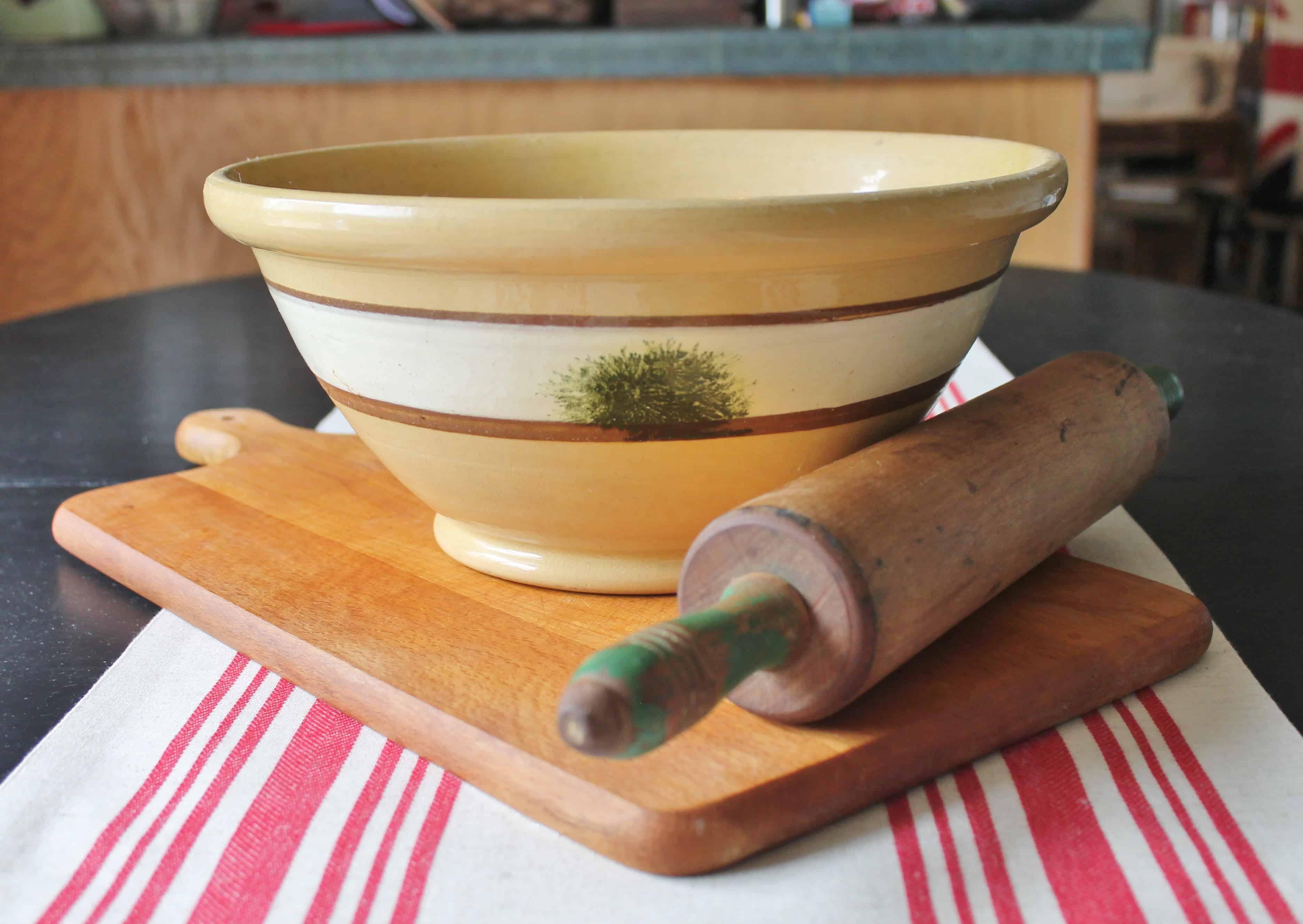 Yellow ware bowl, rolling pin, cutting board (2)
