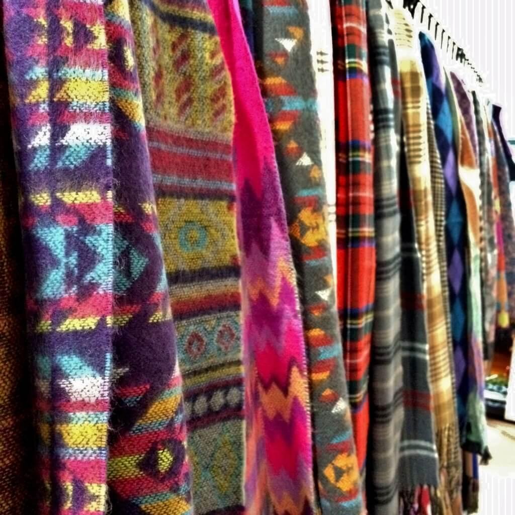 A row of beautiful handmade scarves