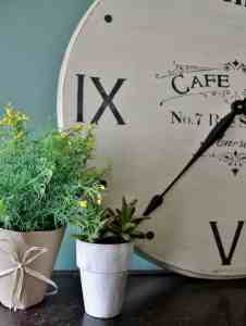 half of vintage clock with plants