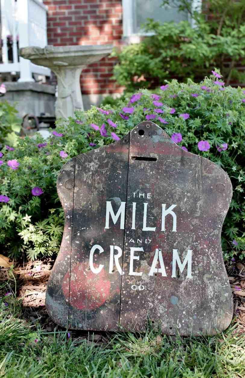 Milk & Cream farmhouse sign in the garden