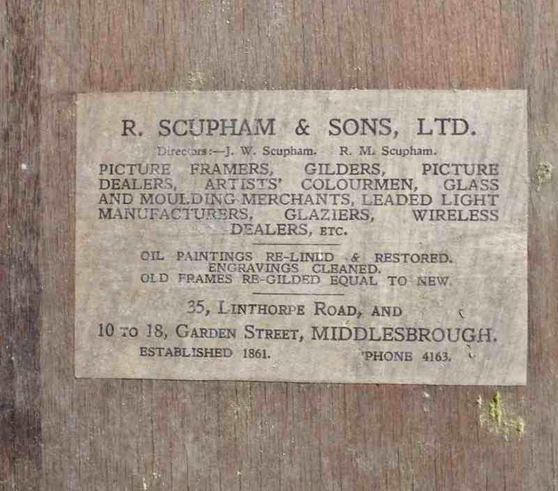 label on back of antique frame