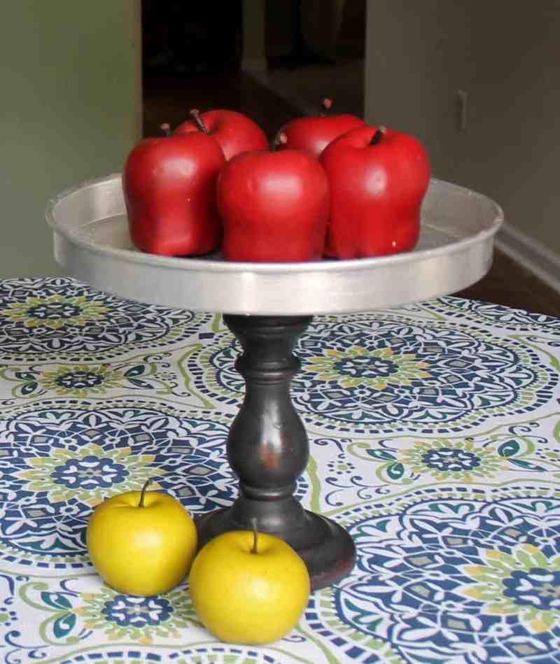 vintage junk pedestal stand with apples