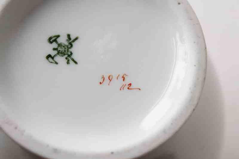 mark on porcelain pitcher with violets