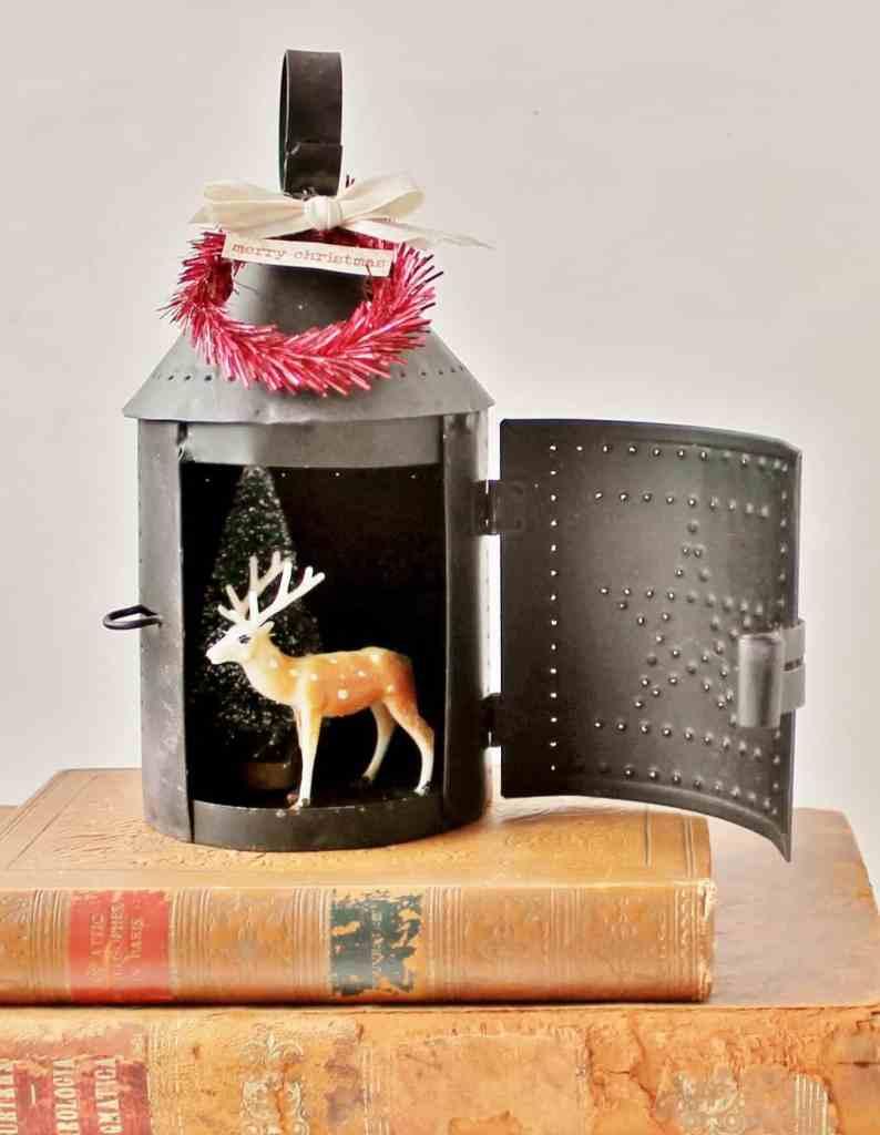 mini lantern diorama with deer