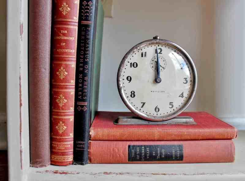 Vintage clock with vintage books