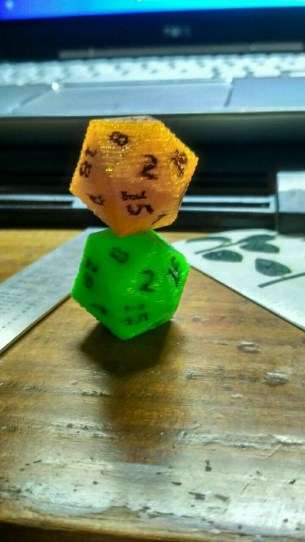 An older D20 (green), and one I just printed (Orange)
