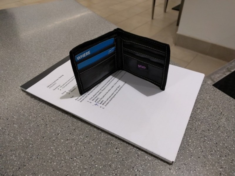 Image shows the two cards used for user testing in a bill fold wallet, and it shows how much of the cards the users will see when they go to retrieve it.