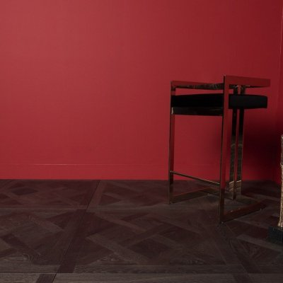 Traino flooring and right corner red walls with props