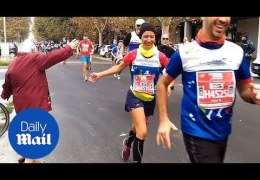 Adorable Italian grandmother high-fives marathon runners