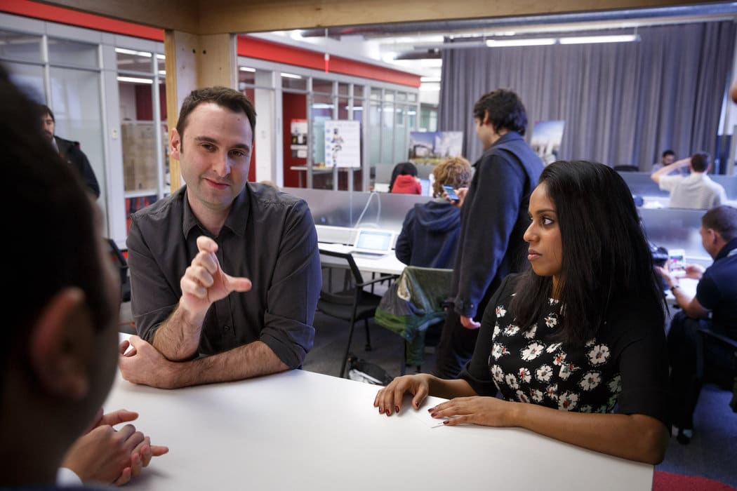Greg Pass, a Cornell Tech leader, with Amanda Emmanuel, a student. Credit Richard Perry/The New York Times