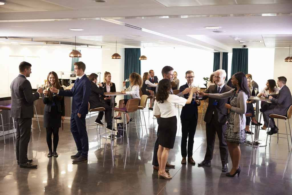 delegates networking at conference drinks receptio P5V59NU scaled