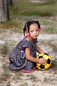 child with yellow football