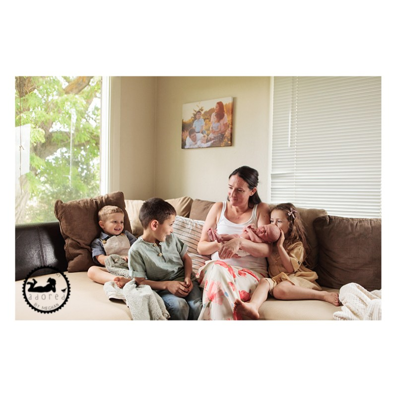 Take it easy with an in-home lifestyle newborn photo session. Easy as the family sitting on the sofa.