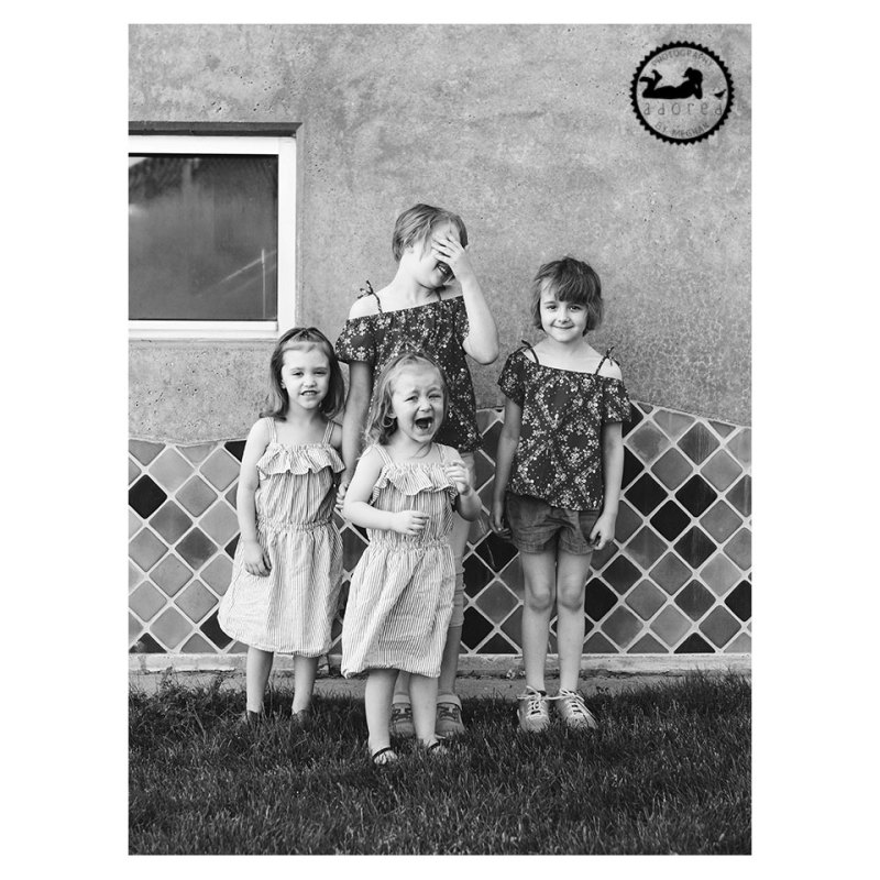 Four girls with a sad crying sister black and white portrait by Adored by Meghan Tri-Cities, WA