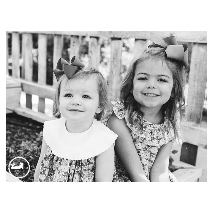 Black and White portrait of Sisters in the garden during mini-session with Adored by Meghan