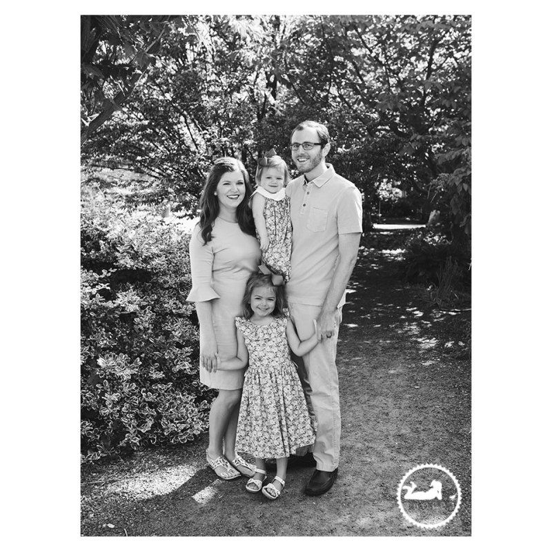 Black and White family portrait in the garden during mini-session with Adored by Meghan