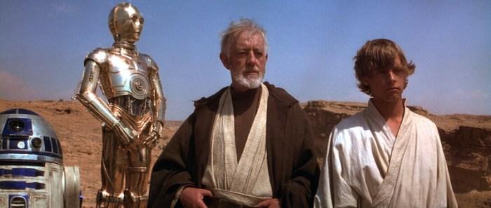 Szenenbild aus STAR WARS: EPISODE IV - A NEW HOPE - Obi-Wan Kenobi (Alec Guiness) tut sich mit Luke Skywalker (Mark Hamill) zusammen um Leia zu retten. - © 20th Century Fox