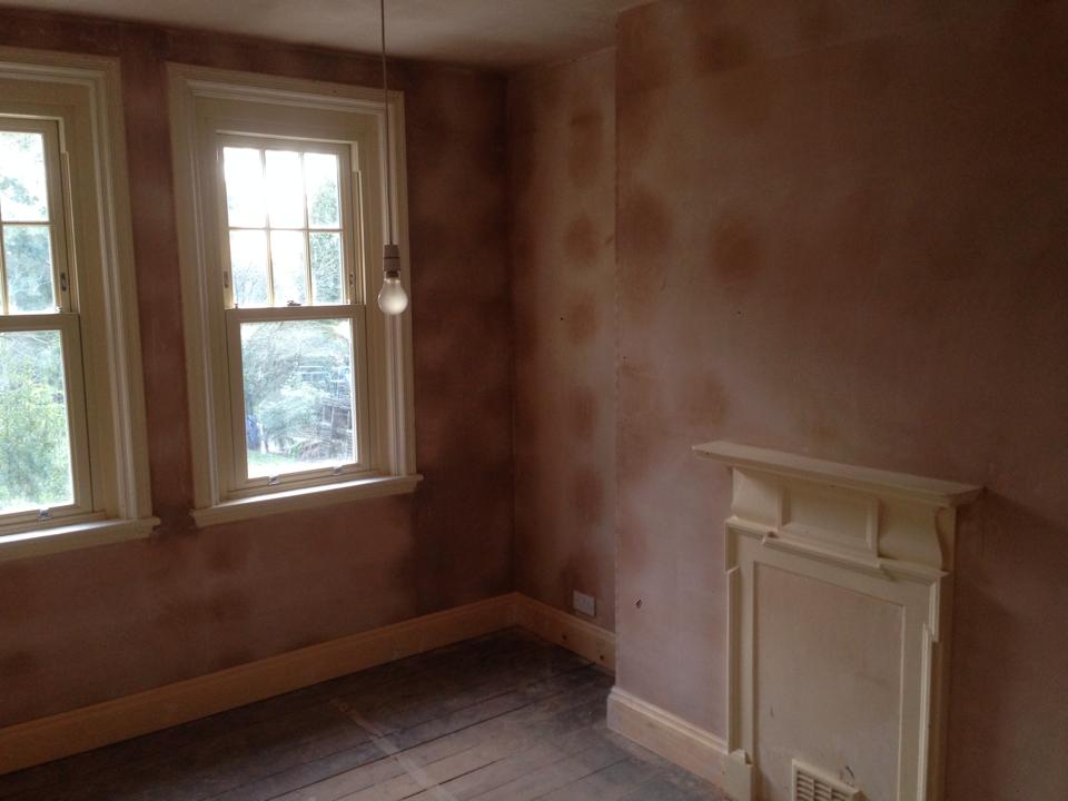 Fresh plastering around window and fire place