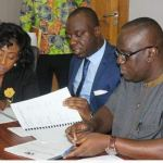 Mr. Owusu-Afriyie (right) and Mr. Justin Kodua (middle) signing the MOU