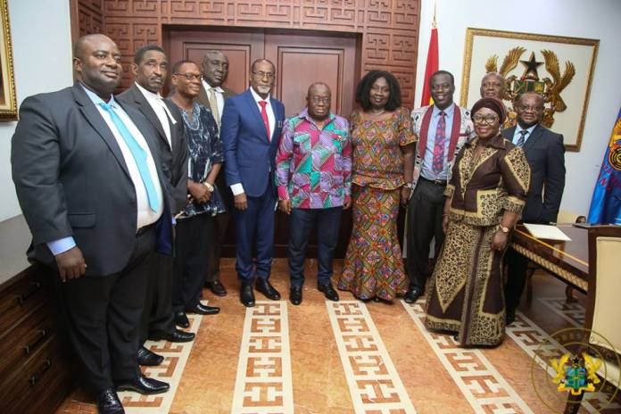 President Akufo-Addo, the Chief of Staff, and Labour Minister in a picture with the Members of the Commission after their inuaguration