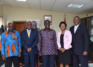 Mr Baffour-Awuah (middle) with Dr Davies (right), Mr Gamey (second left) and other officials after the meeting