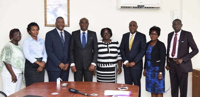 Prof Amartey (fourth left), Dr Davies (third left),Mr Gamey (third right), Mrs Essiaw (fourth right) and others after the meeting at UPSA