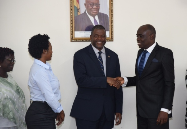 Prof Amartey (right) exchanging pleasantries with Dr Davies at the meeting