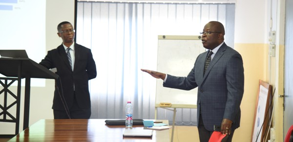 Mr Michael Owusu (right) explaining an issue while Mr Martin Nwosu looks on