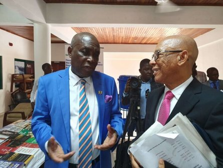 Justice Emile Short (right) and Mr Austin Gamey, Chairman of GCADR Centre in a chat at the siging ceremony