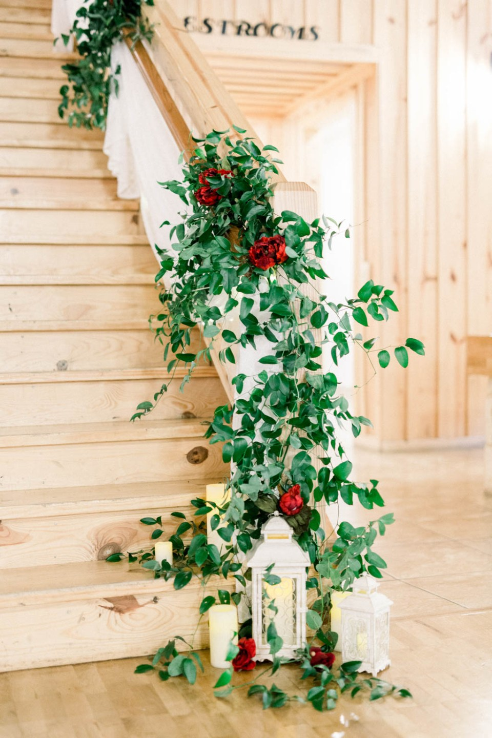 Wedding flowers by Dallas florist Wild Rose Events, photographed by Dallas wedding photographer Adria Lea Photography, flower staircase and wedding greenery