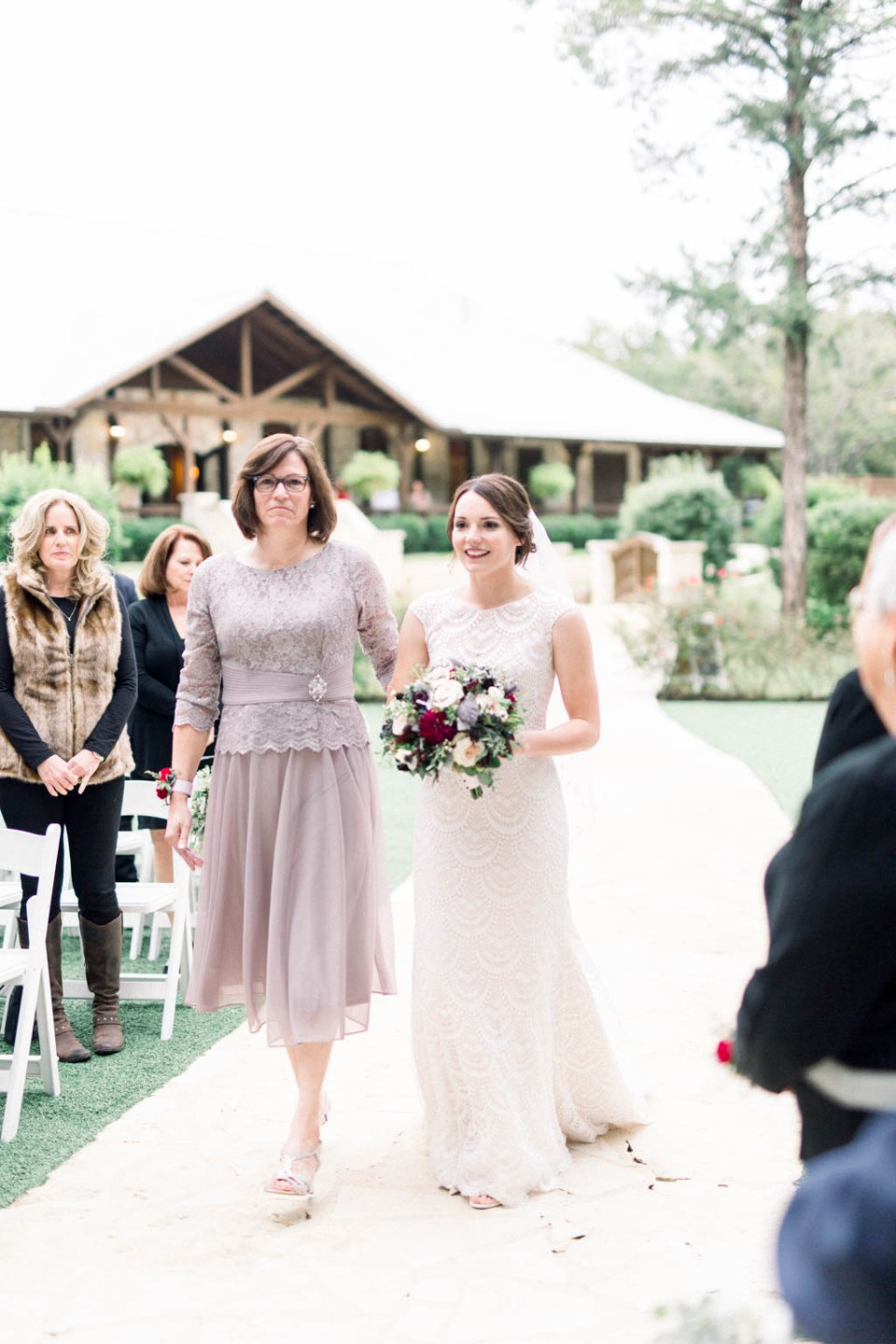 Bride walking down the aisle at The Springs Dallas wedding venue, photographed by Adria Lea Photographer, Dallas wedding photographer