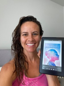 woman holding her tablet with the book of AMA Publishing