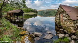 The old boat house at Nant Gwynant Lake, one of the most dramatic and beautiful valleys in Wales. Its northern slopes rise to the summit of Wales highest mountain Snowdon and to the south lies the relatively undisturbed hills of Moel y Dyniewyd and the Moelwynion range.