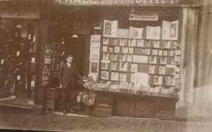 Postcard of Harry Pratley outside Hall's Bookshop circa 1920s.