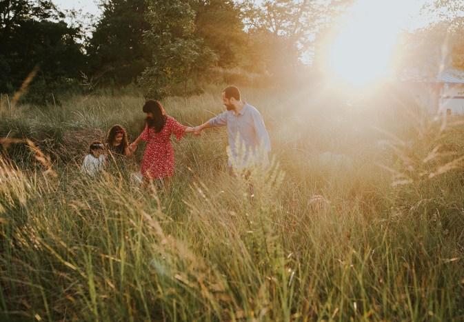 family in beautiful golden field