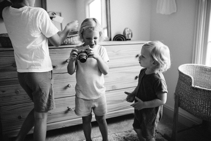kids playing with camera