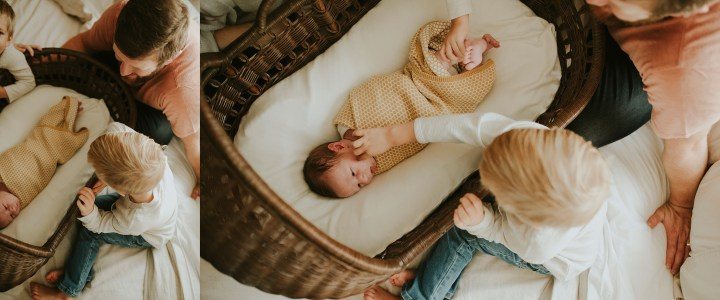 baby in basket and fmily surrounding him