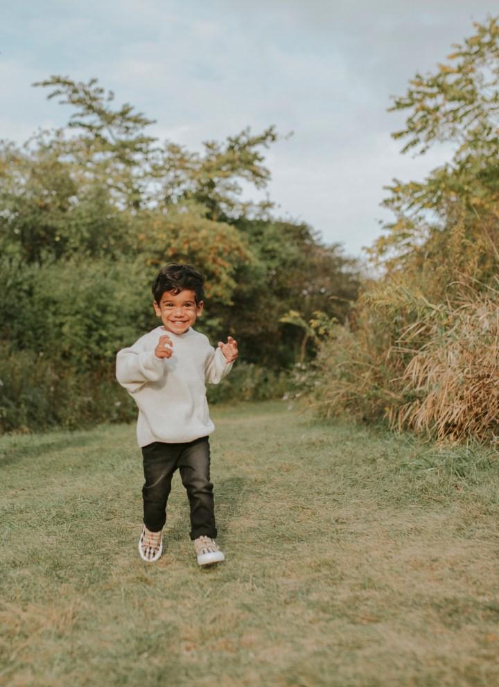 KID RUNNING SMILING