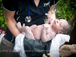 Angharad holding Biro, Bokoro's baby.