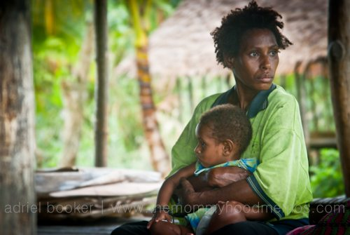 Woman and child. Giving birth in the Bamu River region, Western Province, PNG.