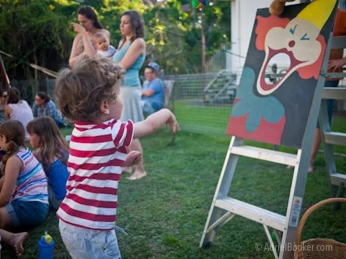 Judah's First Birthday Circus Party - vintage clown bean bag toss party game. (Strap the clown image to a ladder.)