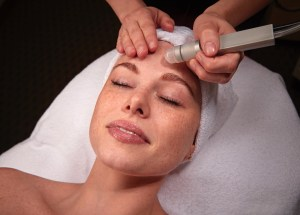 Microdermabrasion on a female client.
