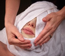 Steam towel removing a mask