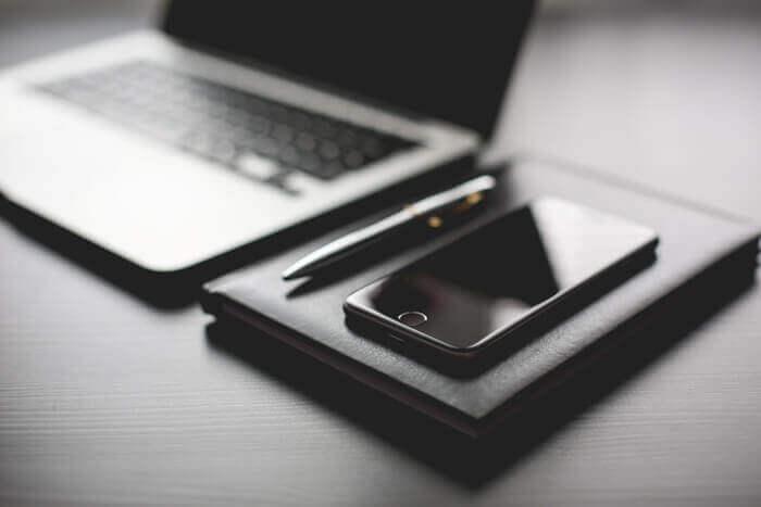all-black-working-setup-diary-and-iphone-picjumbo-com