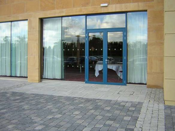 Integrated framed stick curtain walling