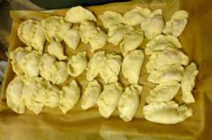 Dumplings on a sheet pan covered with parchment paper