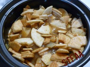 Apples and vegetable stock added to the onion and spice mixture