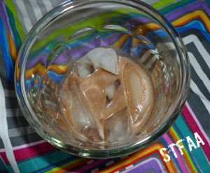 DIY Creme de Cacao Liqueur on the rocks