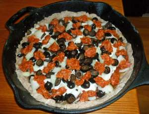 Pizza with toppings before baking